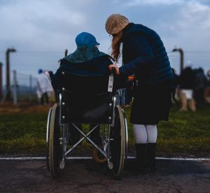 Caregiver and a disabled person in a wheelchair