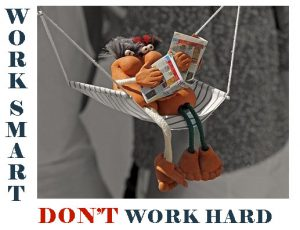 Toy couple in a hammock with magazines: work smart, don't work hard