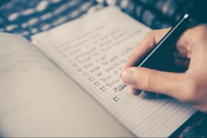 Writing a budget plan by a pen in a notepad