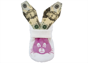 Dollars like rabbit's ears stick out of a sock with a picture of a pink rabbit