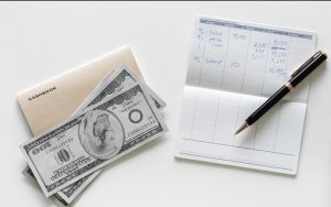Cashbook, pen and cash