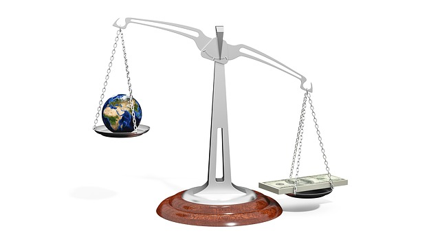 Money and Earth on the scale