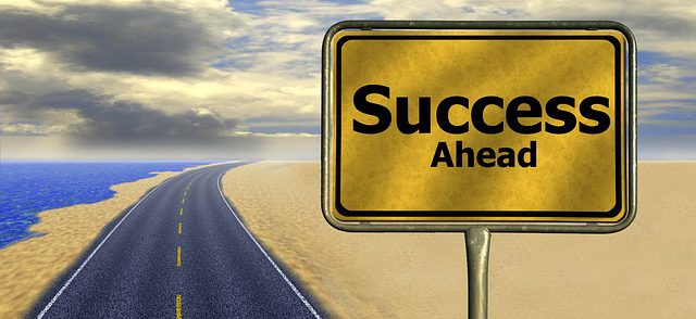 Road sign: Success Ahead.