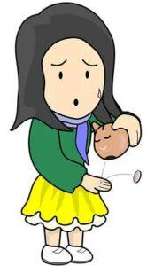 Financially Broke: a sad woman holding piggy bank