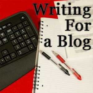 Writing for a blog - featured image: computer keyboard, notepad, and pens on red background