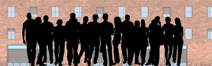 Network Marketing: group of people in front of a building wall.