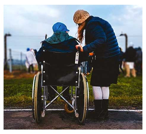 World Financial Group - Long-Term Care: Caregiver and a disabled person in a wheelchair